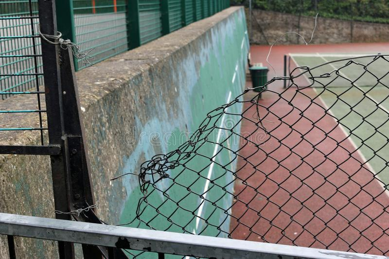 Damaged chain link fencing stock photography