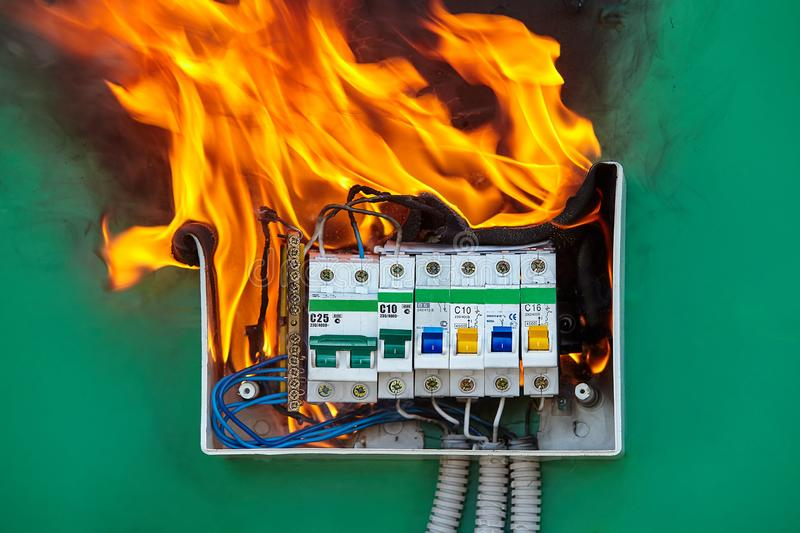 Problem with electrical wiring caused a fire. Damaged circuit breaker became the cause of electrical short circuit and caused the switchboard to ignite of fire royalty free stock photo