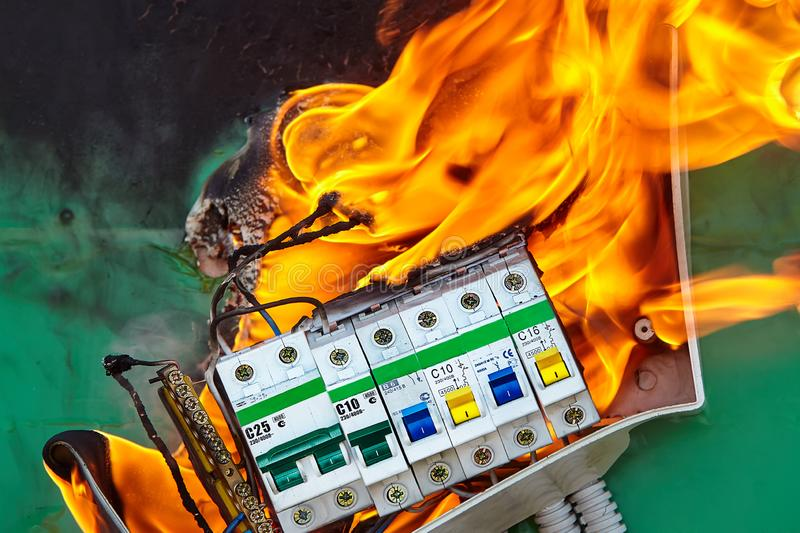 Damaged circuit breaker led to fire in apartment. Bad electrical wiring systems in electrical panel became the caused of fire royalty free stock photos