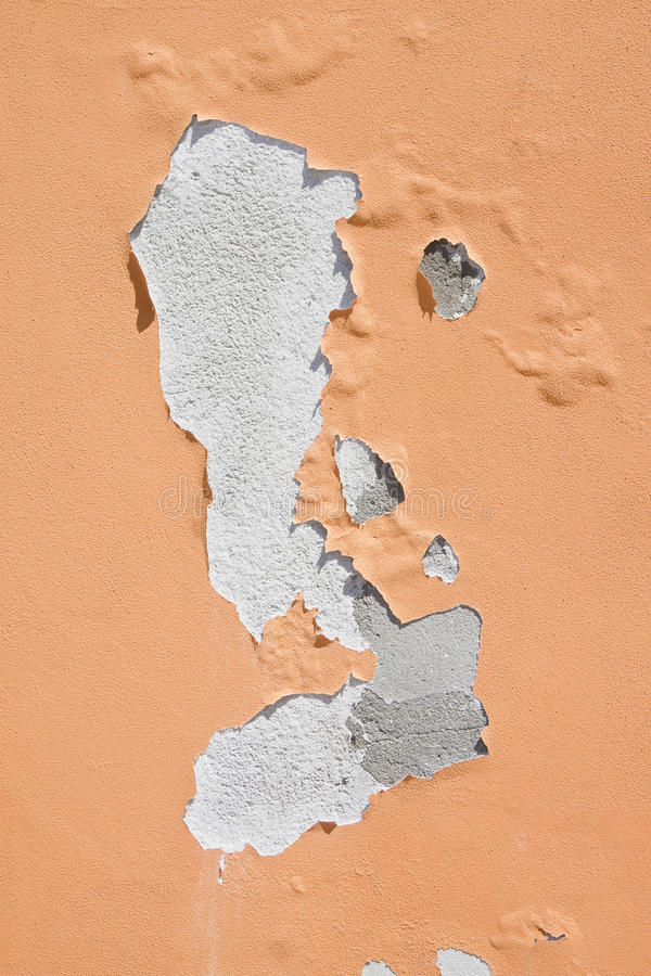 Damaged colored plaster - concept image useful image also to express the concepts of: aging, decadence, aging of human skin and so. On royalty free stock photos