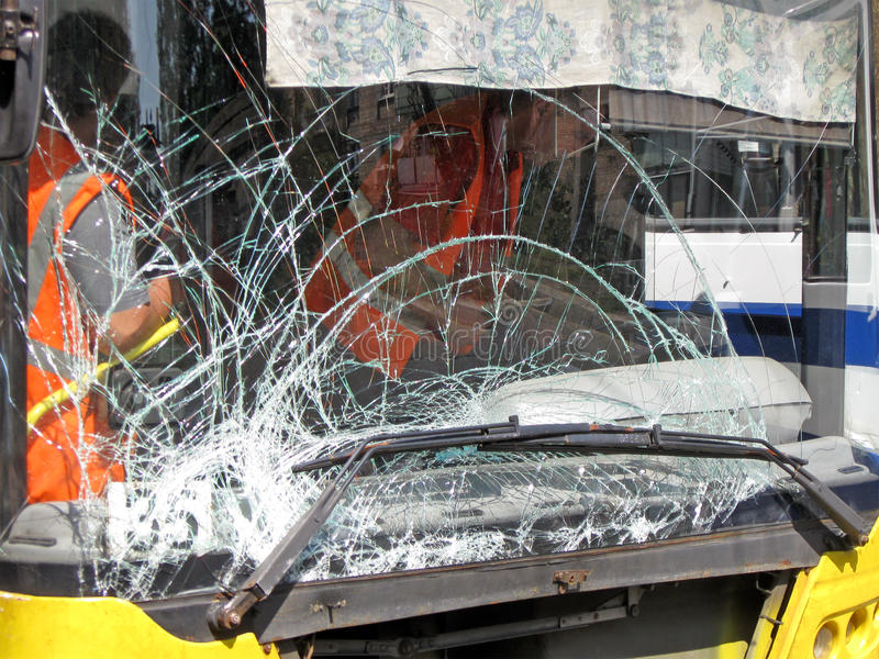 Damaged glass on bus, road accident details, royalty free stock photo