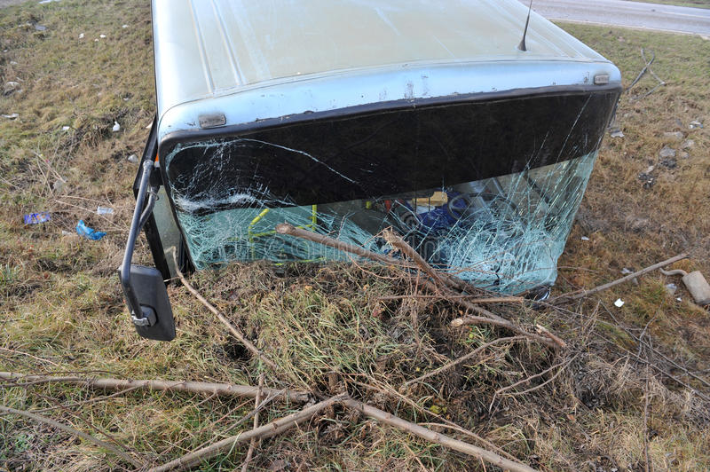 Damaged glass on bus, road accident details, stock image