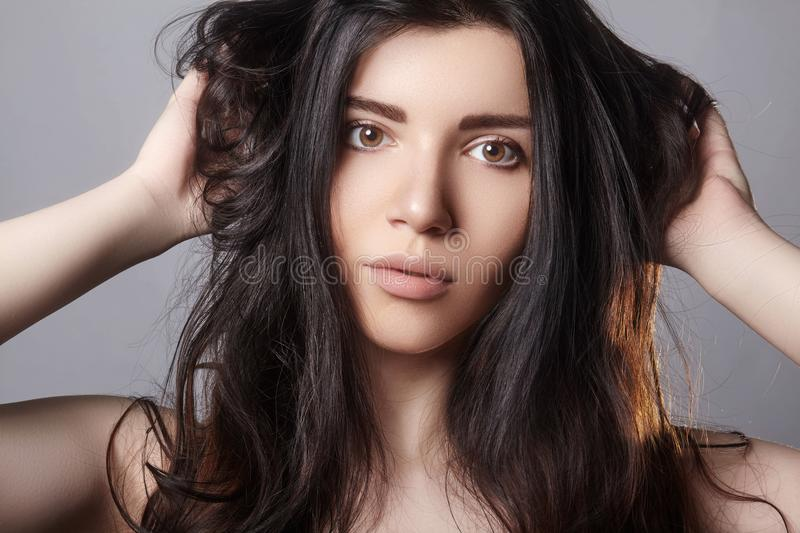 Damaged Hair. Model Holding Messy Unbrushed Dry Hair In Hands. Health And Beauty. girl with brown hair stock image