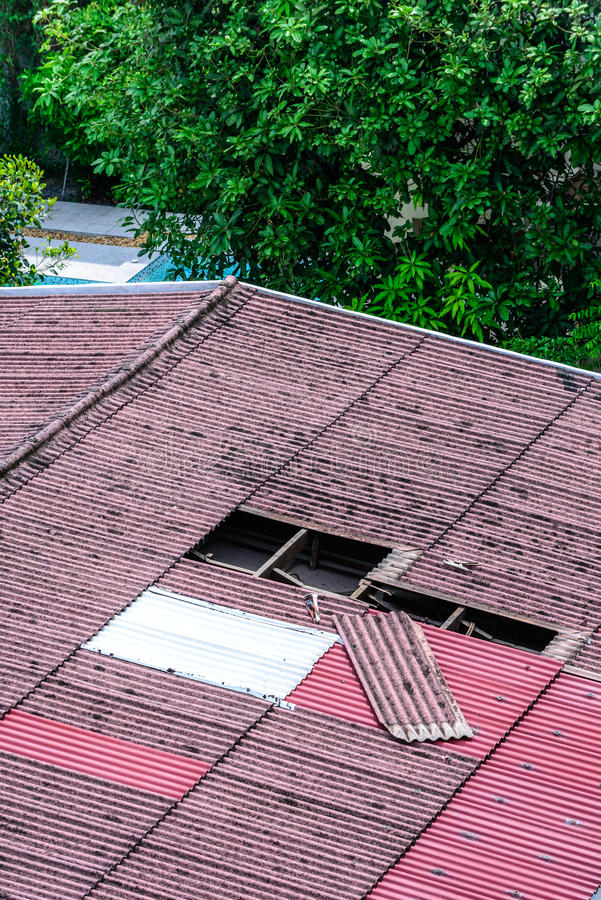 Damaged old tiles roof, need to replacement.  stock photo