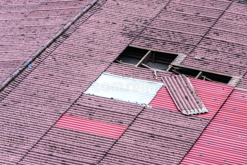 Damaged old tiles roof, need to replacement.  stock photography