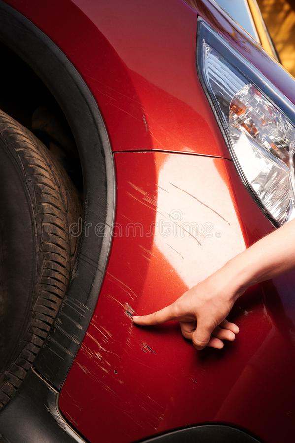 Damaged red car paint on bumper royalty free stock image