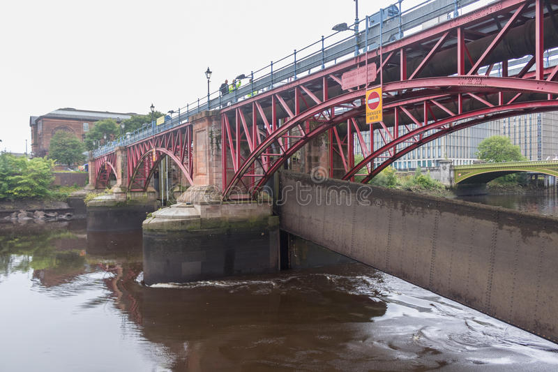 The damaged River Clyde Weir after recent flood. The Weir in Glasgow showing recent flood damage. River level very low with potential for collapse of the banks royalty free stock images