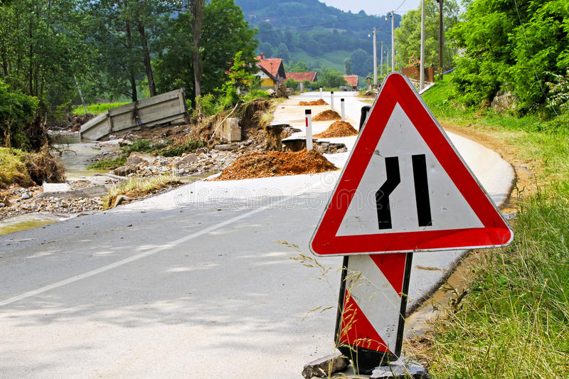 Damaged road. Damaged side of the road after destructive flood royalty free stock photography