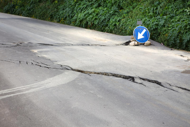 Damaged road with big cracks stock photos