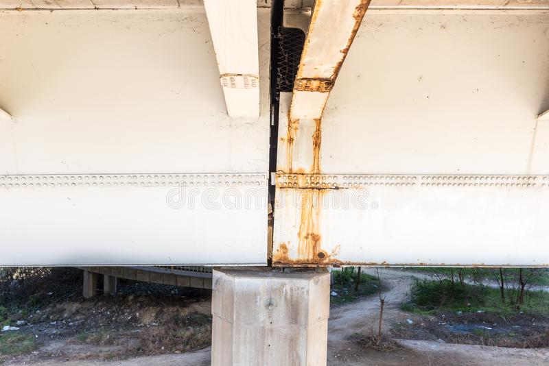 Damaged and rusted metal bridge construction with rust and corrosion on connected part with bolts danger for use in transportation stock image