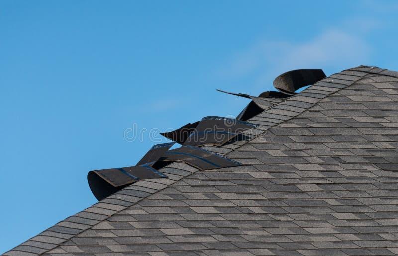 Damaged shingle roof stock photo