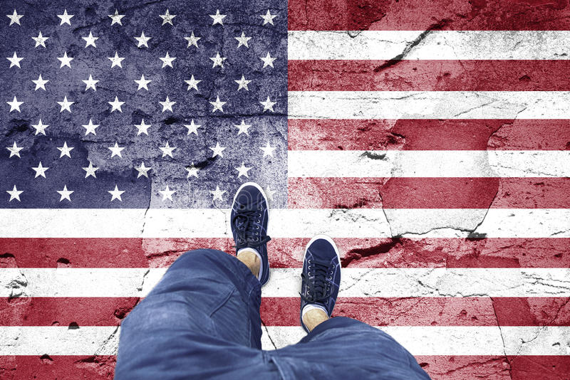 Damaged Usa flag with a man stock photos