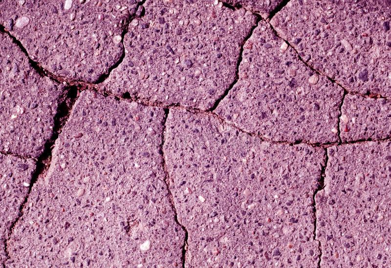 Damaged violet toned asphalt texture. Abstract background and texture stock photo