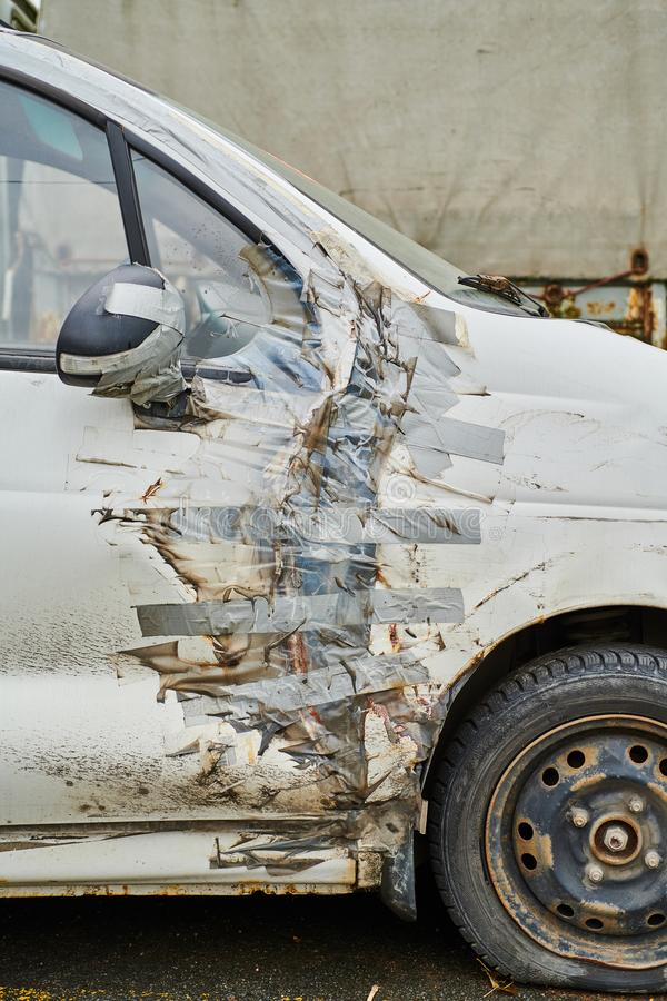 Car with duct tape repair royalty free stock photography