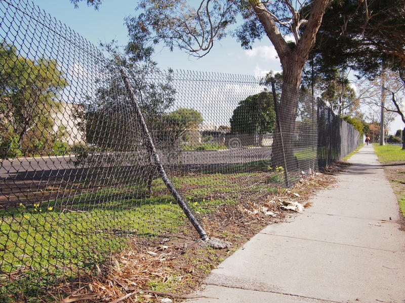 Damaged wire security fence after a car impact. Melbourne 2016 stock photography