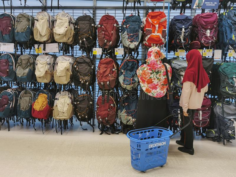 DAMANSARA, MALAYSIA-SEPTEMBER 6, 2019 : Unidentified Muslim women shop for backpacks at Decathlon Sports Centre in Damansara, stock photos