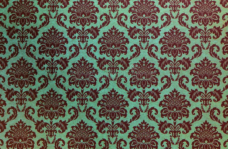Damask repeat pattern on old paper. royalty free stock image