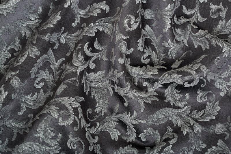 Damassé, fond noir onduleux de texture photographie stock
