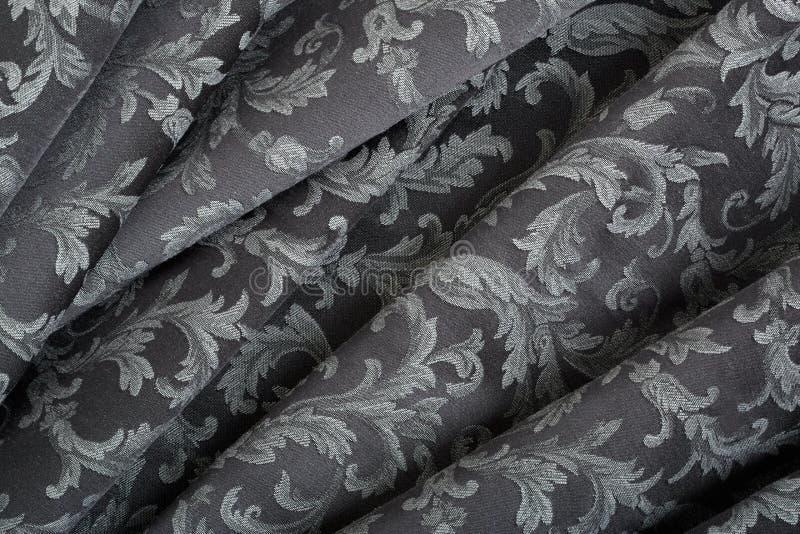 Damassé, fond noir onduleux de texture de tapisserie images stock
