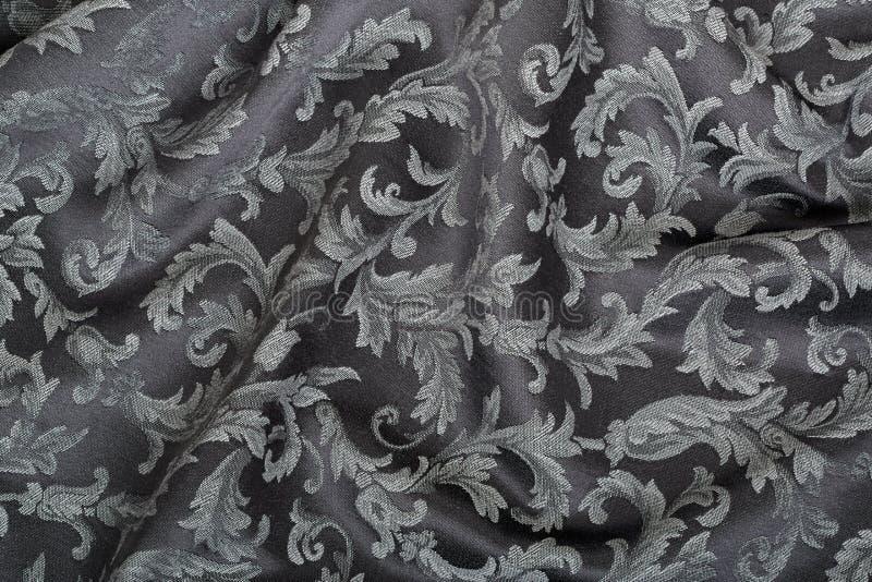 Damassé, fond noir onduleux de texture de tapisserie photographie stock