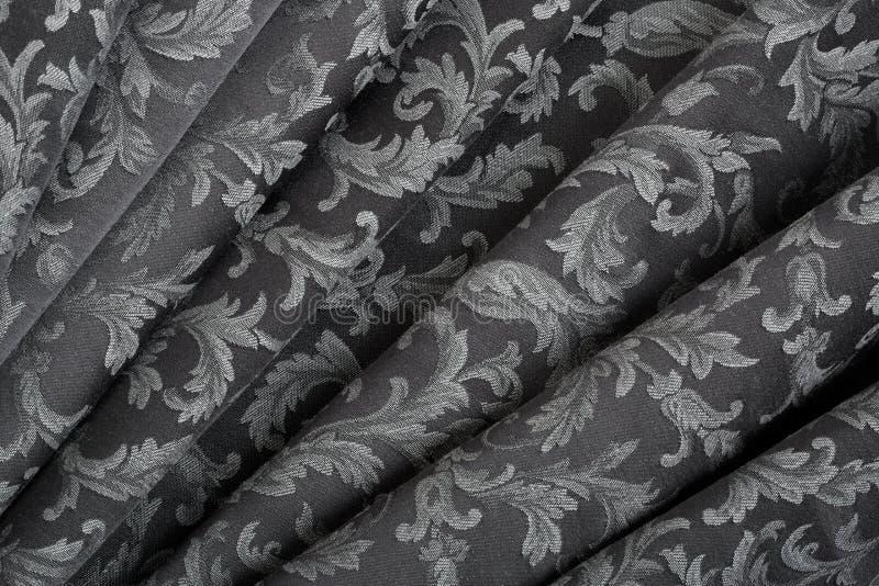 Damast, golvende zwarte textuurachtergrond stock foto's