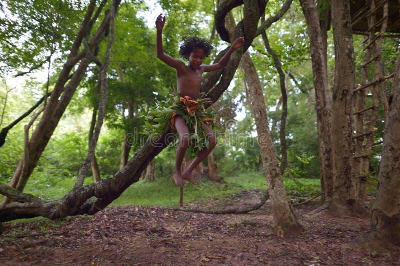 Dambana, Sri Lanka, November 12, 2015: Indigenous young boy, Mowgli lookalike stock images