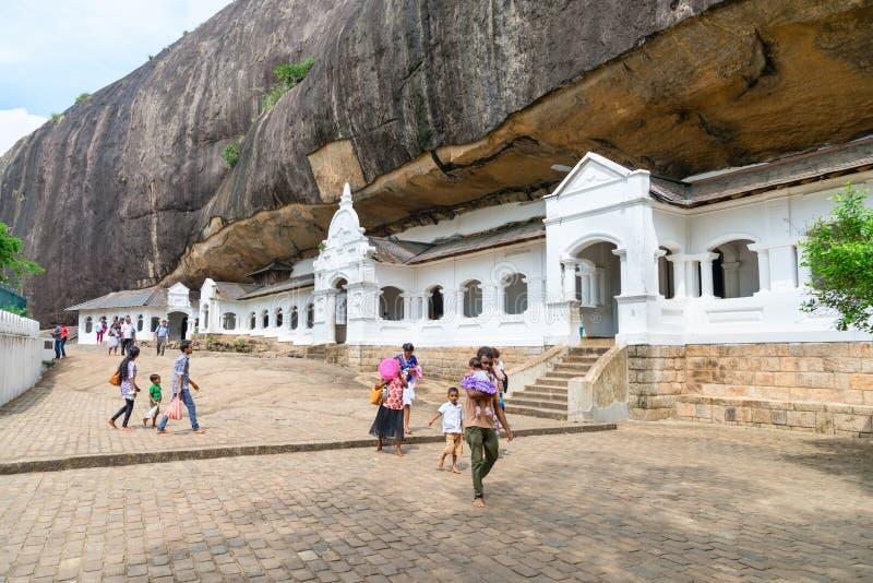 Dambulla golden temple cave complex buildinds is destination for. DAMBULLA, SRI LANKA - NOV 2016: Golden temple cave complex buildinds carved in the rock is stock image