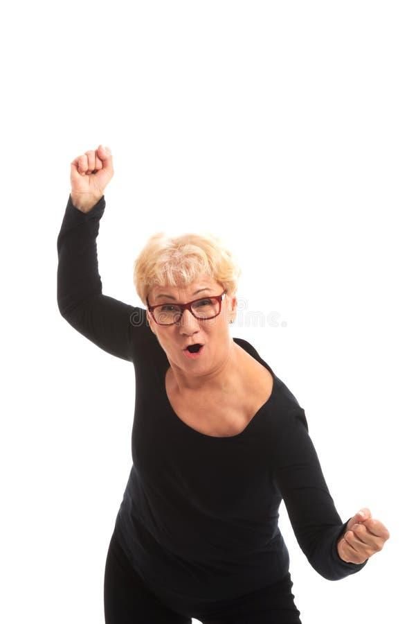 Dame âgée heureuse ayant fermé des poings. photographie stock