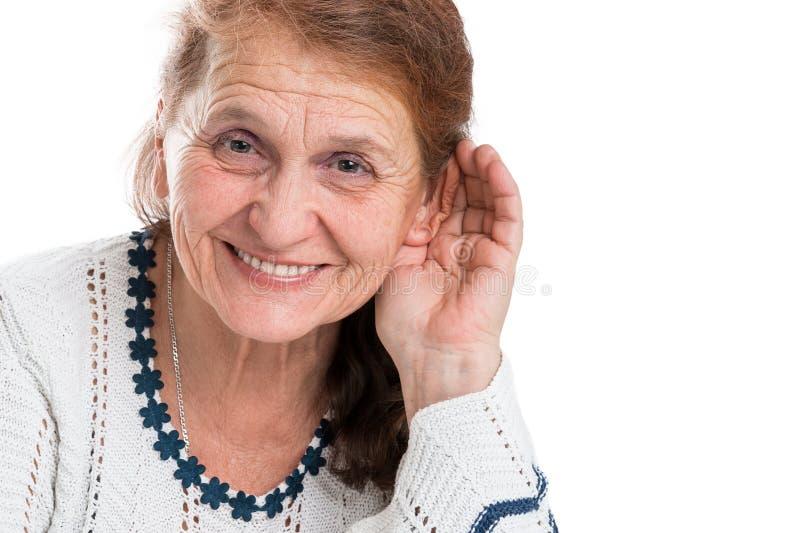 Dame âgée qui se réjouit cela peut entendre image libre de droits