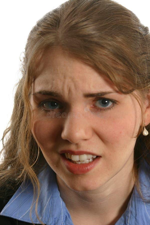 Dame assez jeune avec l'expression du dégoût photo stock