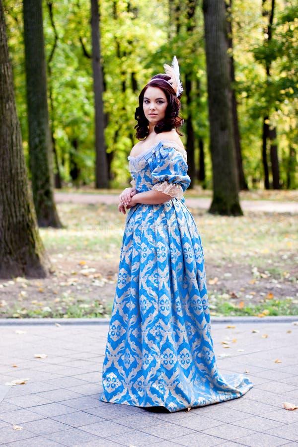 Dame in blauw stock foto