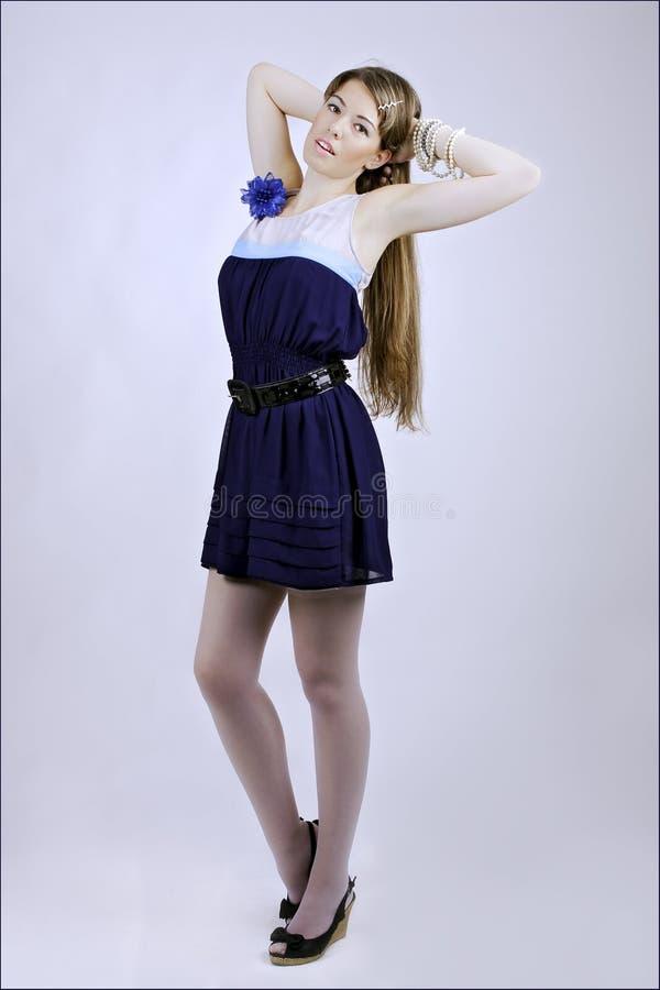 Dame in blauwe kleding royalty-vrije stock afbeeldingen