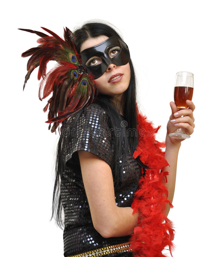 Dame in buitensporig masker met een glas wijn stock foto