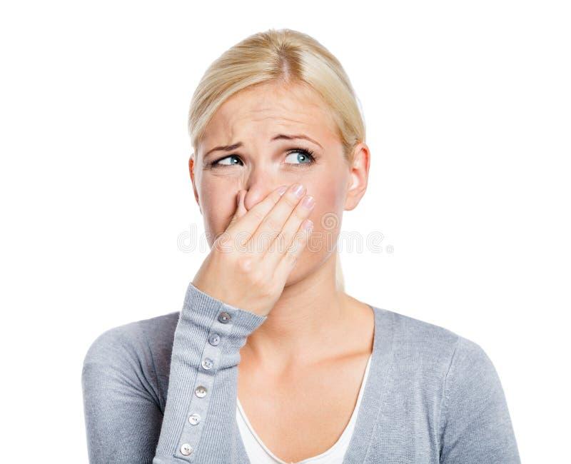 Dame deckt Wekzeugspritze mit der Hand ab stockfotografie