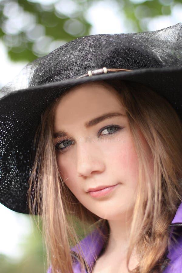 Dame in een hoed stock foto