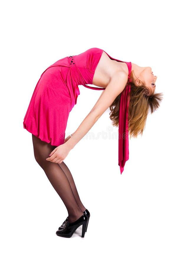 Dame in einem rosafarbenen Kleid lizenzfreies stockfoto