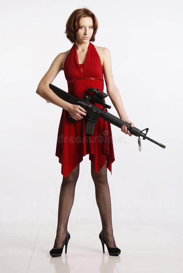Dame en geweer stock afbeeldingen