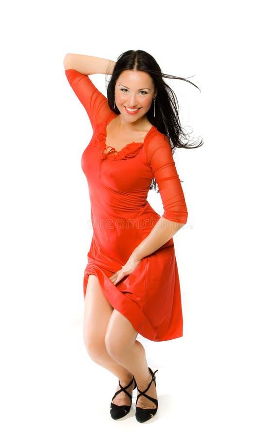 Dame im roten Kleid stockbild