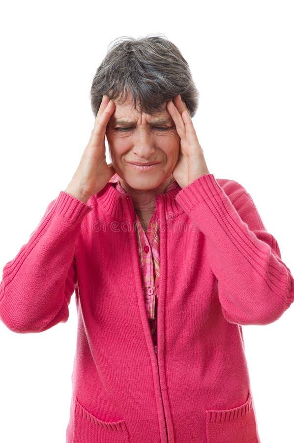 Dame met hoofdpijn stock foto