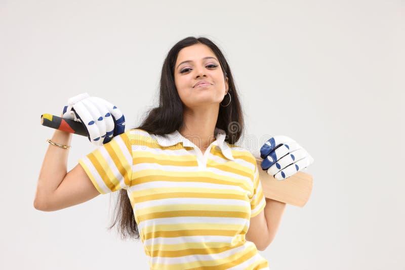 Dame mit dem Kricketschläger lizenzfreies stockfoto