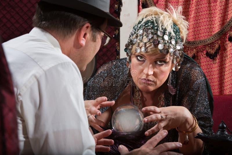 Dame Reading Crystal Ball stockbild