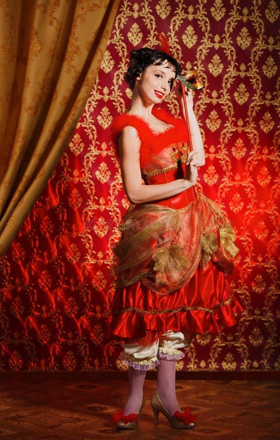 Dame in rode kleding royalty-vrije stock afbeelding