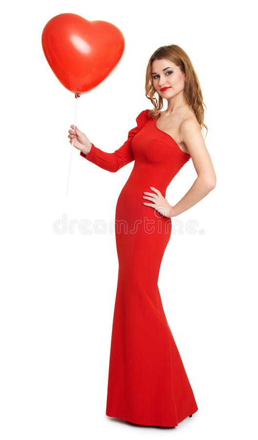 Dame in rode kleding met ballon in hartvorm, romantisch concept stock foto's