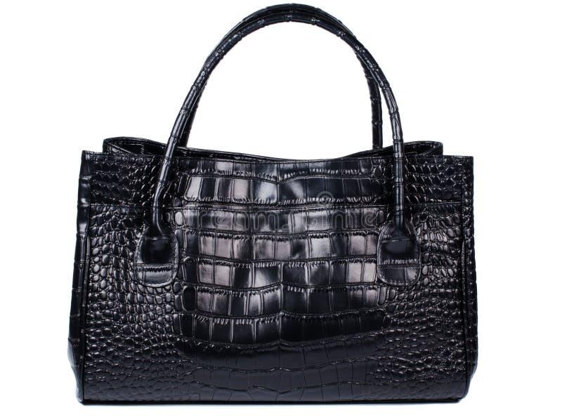 Damenhandtasche in der schwarzen Farbe gemacht vom Krokodilleder stockbilder