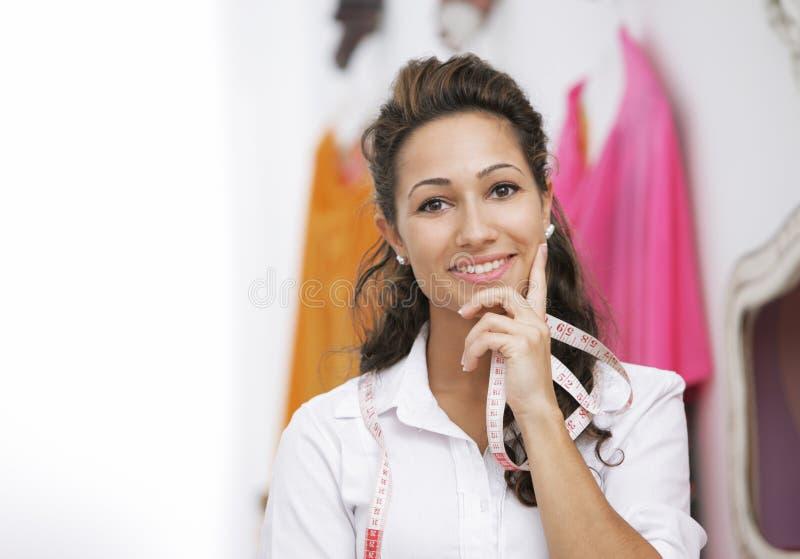 Damenschneiderin stockfotos