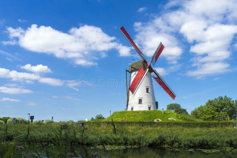 Damme Belgium Windmill. Belgium, West Flanders Vlaanderen, Damme. Hoeke Mill Hoekemolen windmill on the Damse Vaart canal royalty free stock photos