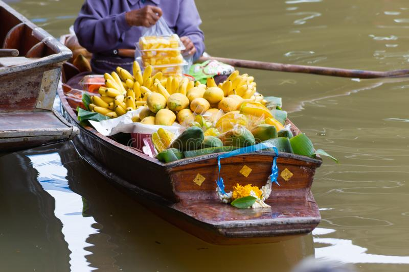 Damnoen Saduak Floating Market, Thailand small boats laden with colourful fruits and vegetables. And paddled by Thai women, concept Lifestyle, culture Thailand stock photo