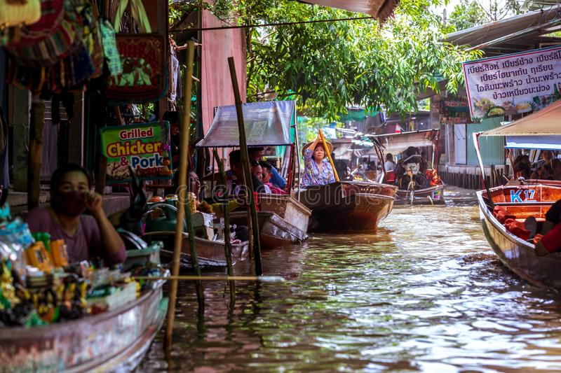 Damnoen Saduak Floating Market, tourist attraction.  Thailand. Damnoen Saduak / Thailand - July 23, 2019: Floating Market, tourist attraction, attracting stock images