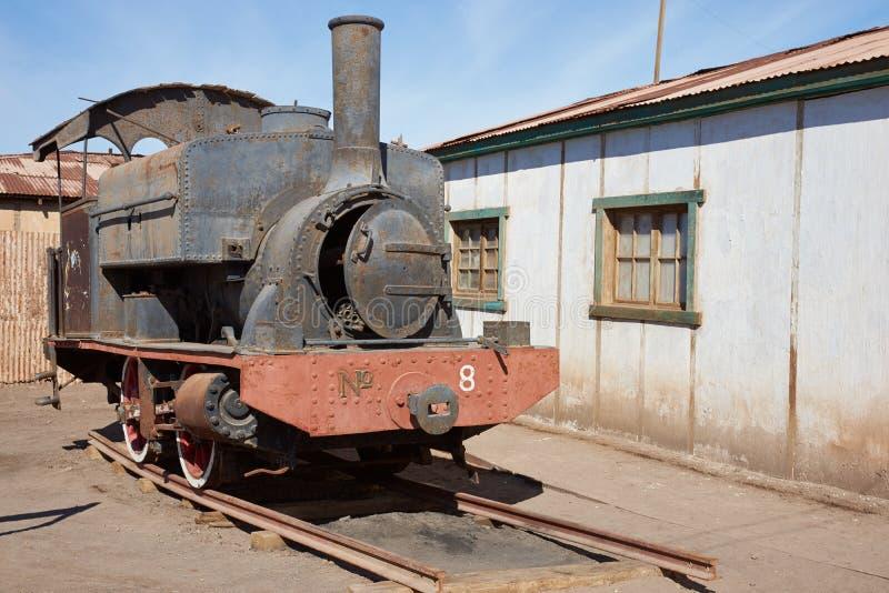 Dampf-Lokomotive bei den Humberstone-Salpeter-Arbeiten lizenzfreie stockbilder