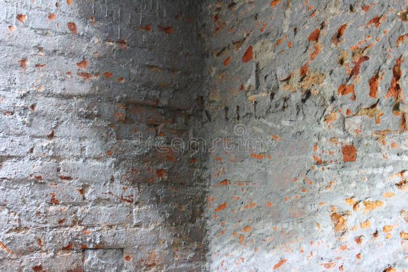 Dampness on walls. Dampness due to water leakage visible on brick walls covered with a layer of cement royalty free stock photography